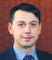 Maciej Guzek doradca podatkowy w Deloitte